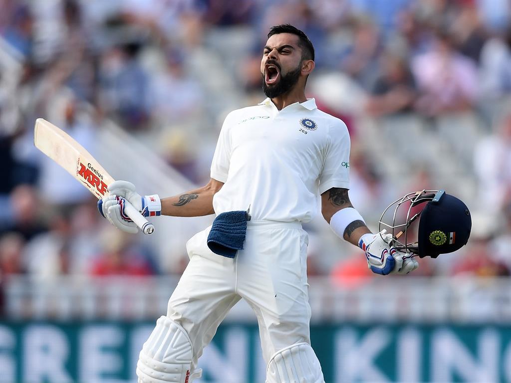 Roaring back Kohli celebrates his brilliant hundred for India