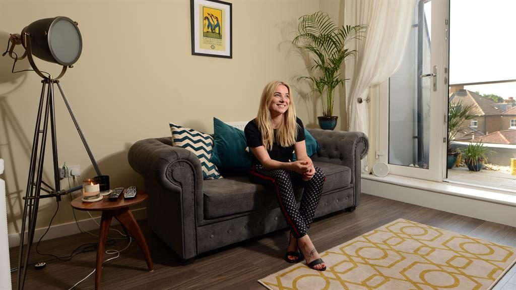 Sitting pretty: Sian says she is thrilled to finally have a sofa to herself