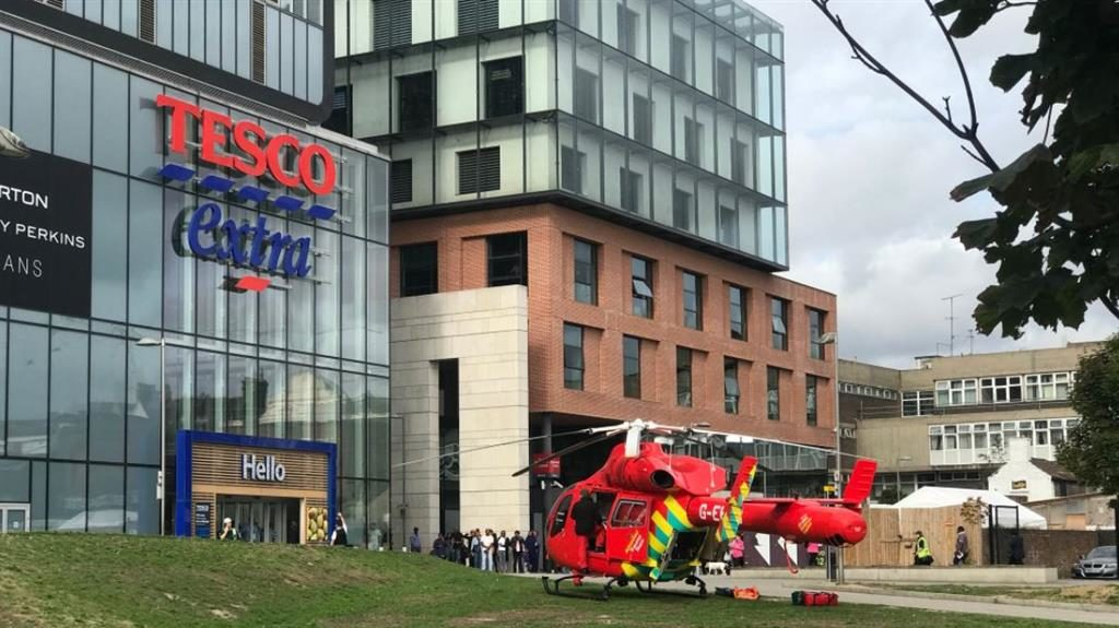 Airlift: An air ambulance lands at a nearby Tesco. Last night police arrested Peter Morley (inset) PICTURES: PA