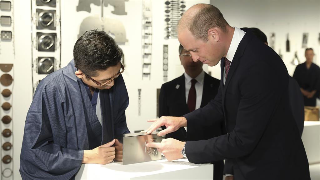Craft work: Duke is shown a designed piece of 'magic metal' by Ritsu Yamanda PICS: PA