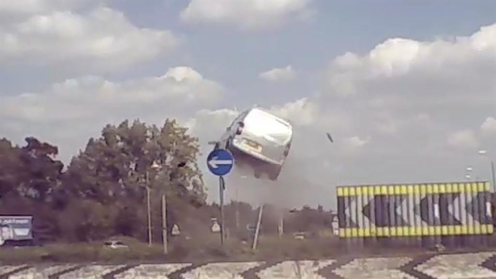 Lift-off: The van careers through the air on the A11 in Norfolk. A witness whose helmet cam captured the incident claims the driver suffered only minor injuries PICS: SWNS