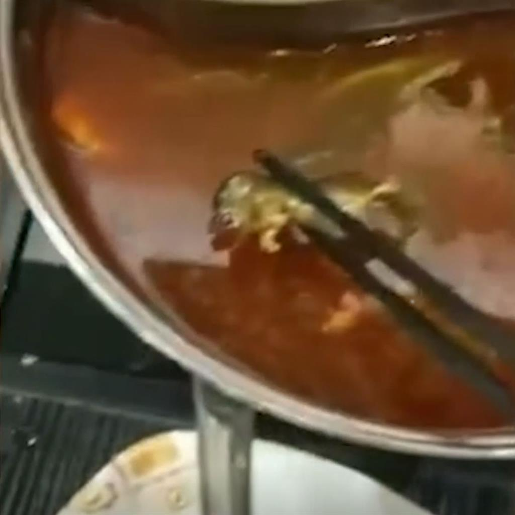 Yuck: Clips of the dead rat being fished out of the soup with chopsticks went viral. The bill shows hotpot order PICTURE: SOUTH CHINA MORNING POST