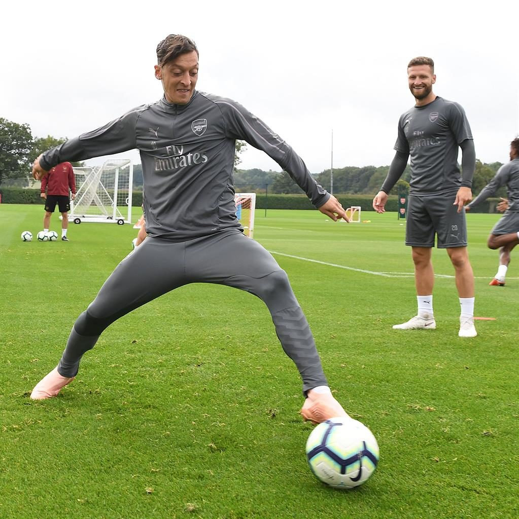 At ease: Ozil appears settled in training ahead of tomorrow's trip to Newcastle