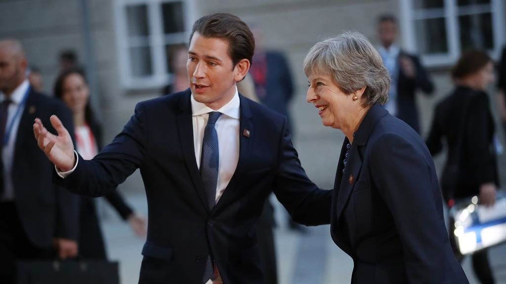 Welcome Theresa May is greeted by Austrian Chancellor Sebastian Kurz in Salzburg last night