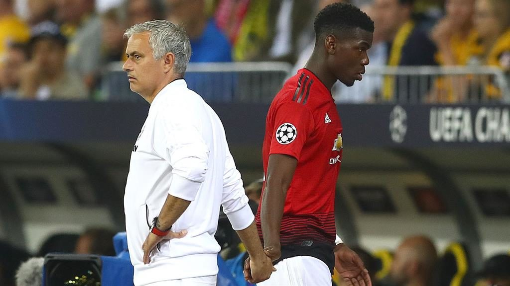 Put it there: Paul Pogba is greeted by Jose Mourinho after being substituted against Young Boys PICTURE: REX