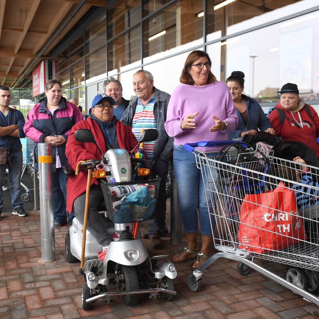 Early doors: Delia Fernandez is first in line at opening of Cambridgeshire store (below)
