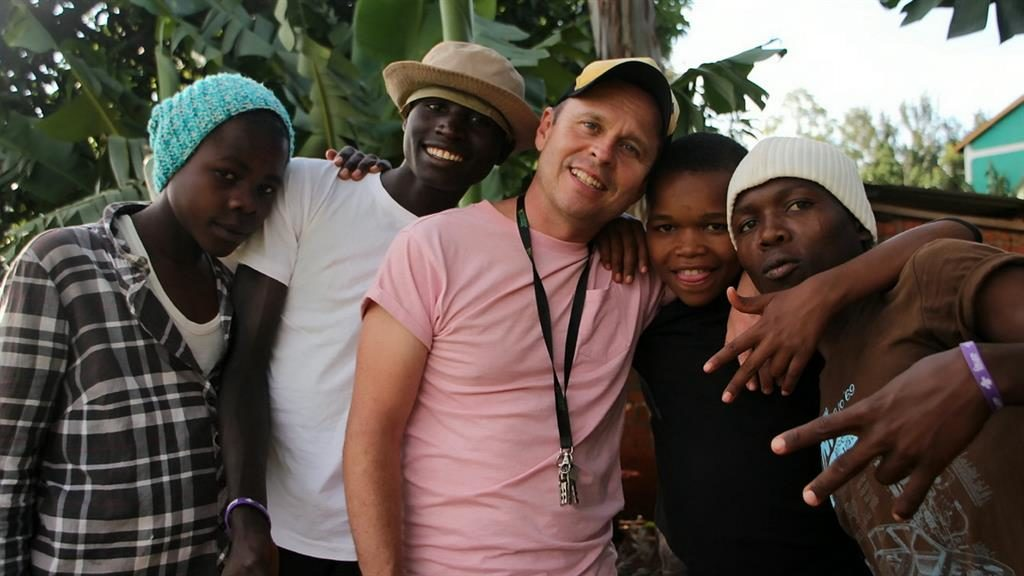 Supportive: Chris Dade (centre) with four of the 74 street children he has adopted in Kenya