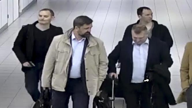 Not-so-secret service: Spies, from left, Evgenii Serebriakov, Alexey Minin, Oleg Sotnikov and Aleksei Morenets, head for a flight after being kicked out of Netherlands and (below) their diplomatic passports