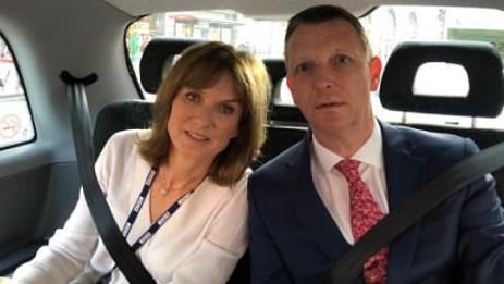 Dash cam: Fiona Bruce and Mark Easton in a taxi before switching to a police car