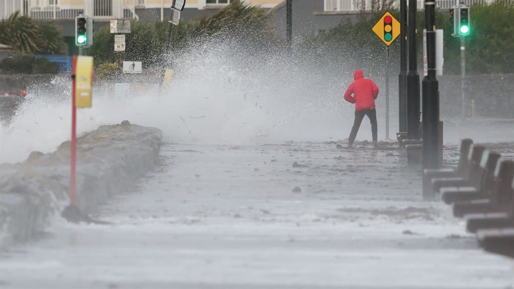 Gales: A man avoids the waves at Salthill promenade, Co Galway
