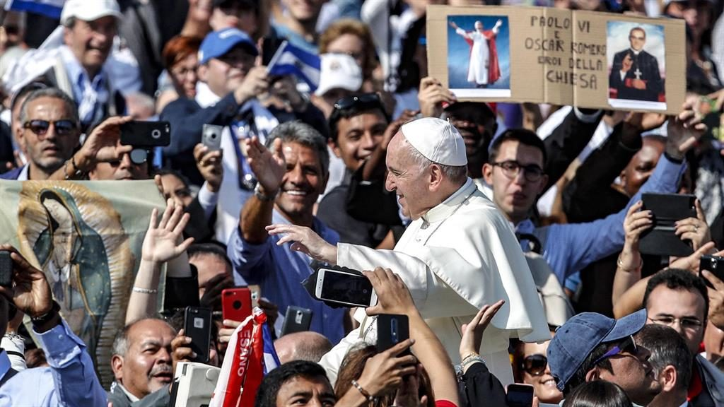 Crowd pleaser: Francis greets crowds after canonising Óscar Romero and Paul VI PICTURE: EPA