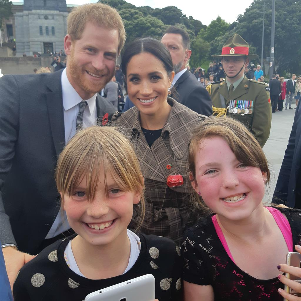 Worth every minute: Sophie Hubbard and Hope Watson, both 10, bag a picture with Harry and Meghan PICTURES: PA/REX