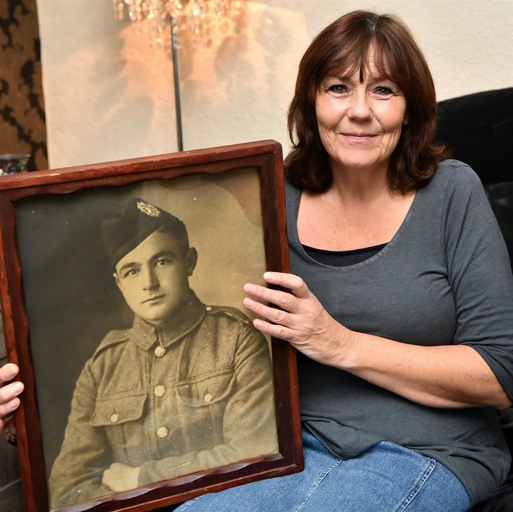 Poignant: Sheena MacLean with the framed picture of her great-uncle, underage soldier Edward Martindale, in his WWI uniform PICTURES: SWNS