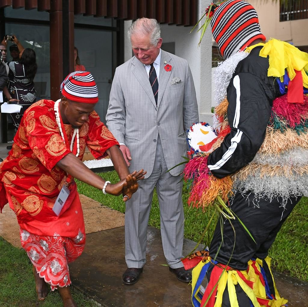 Royal rhythm: The prince watches dancers at the British Council arts festival in Lagos, Nigeria, during royal trip to west Africa PICTURE: PA