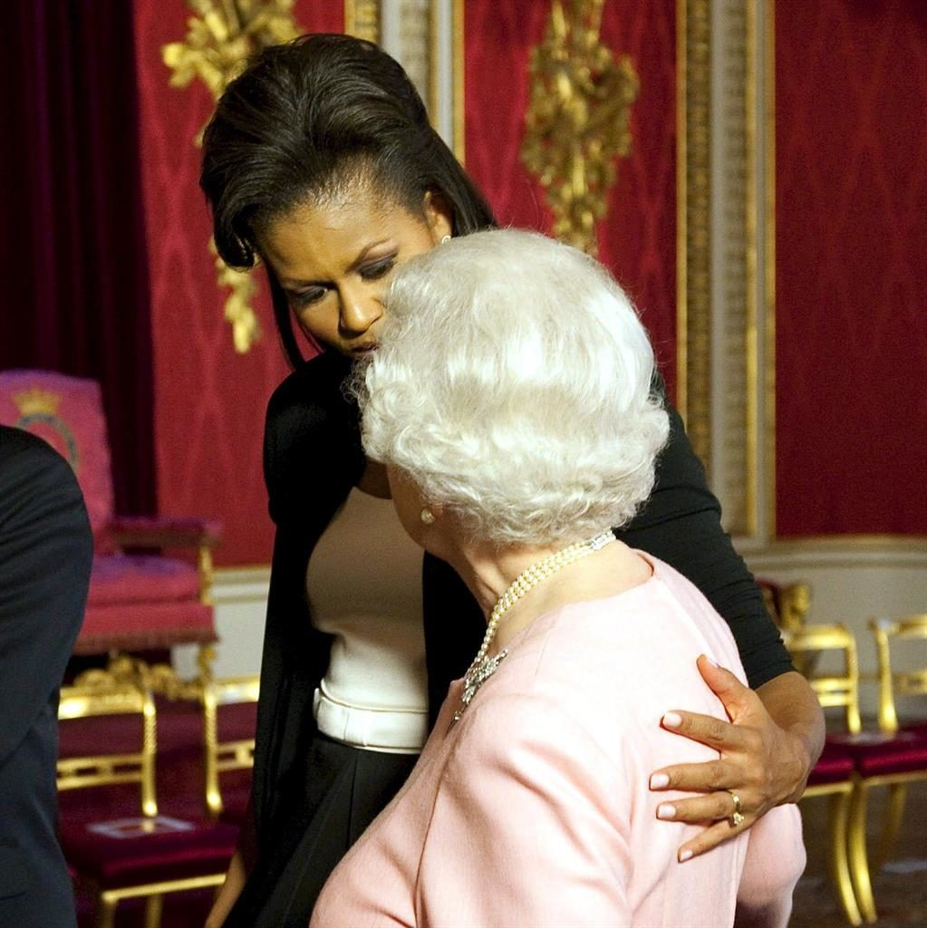 'Epic faux pas': Michelle Obama puts her arm around the Queen's shoulder at the reception for G20 leaders PICTURE: EPA