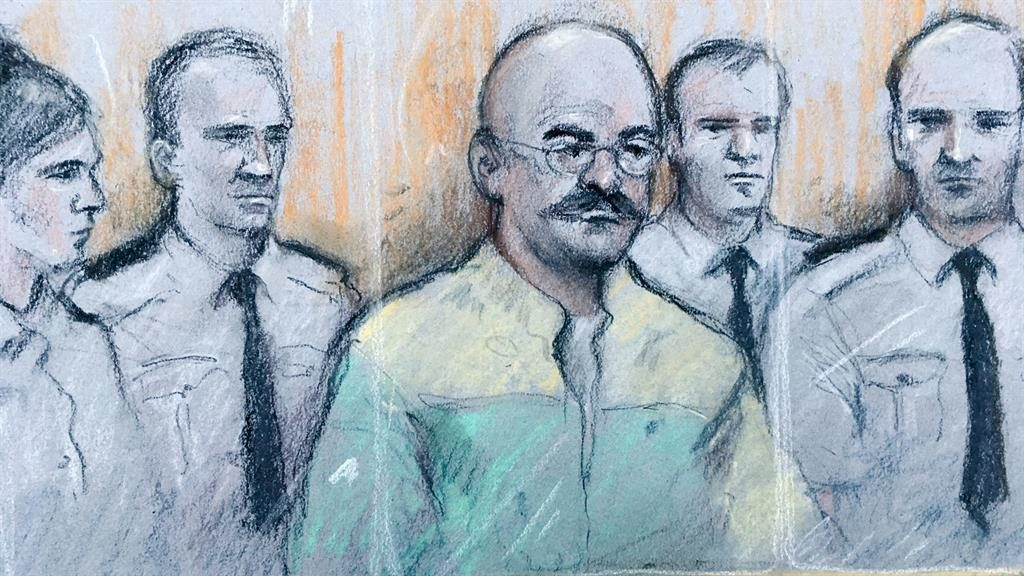 'Gentle bear hug': Charles Bronson, surrounded by guards in the dock, says he had no violent intentions PICTURE: ELIZABETH COOK/PA