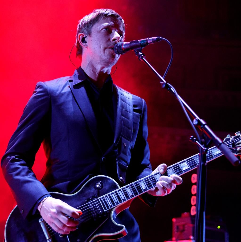 No surplus fat: Interpol are one of those bands who look as sharp as they sound. Lead singer Paul Banks at the Royal Albert Hall PICTURE: BURAK SINGI/REDFERNS