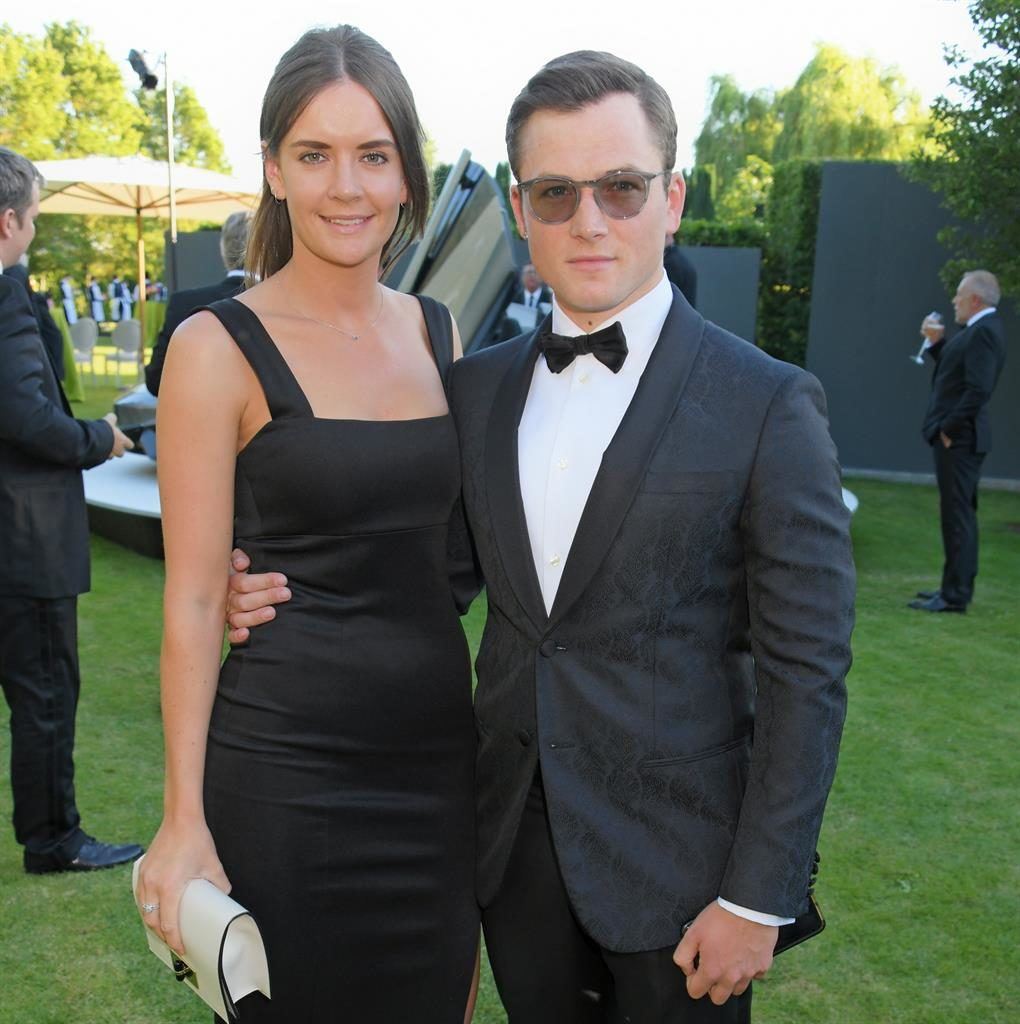 Break-up: Taron with his ex-lover Emily Thomas PICTURE: GETTY