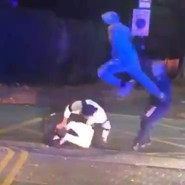 Flying kick: Clip of the attack on police officers in Merton