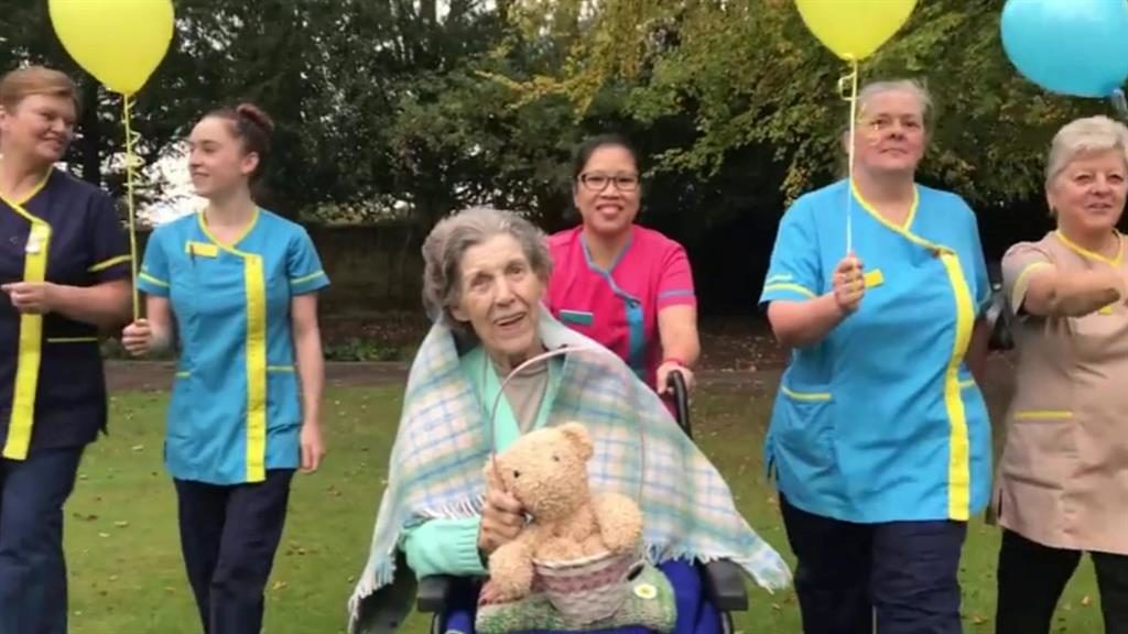 Grand fur-nale: Jean Clews, 87, smiles as home staff prepare to give teddy lift-off with helium balloons PICTURES: SWNS