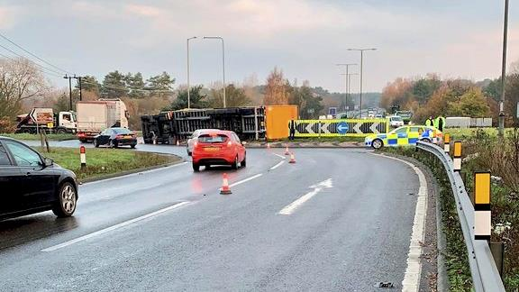 Crash course: Overturned lorry on A11. Police criticised motorists for taking phone pictures at the scene PICTURE: SWNS
