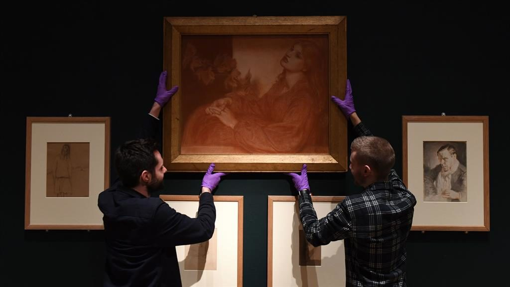 Frame at last: Workers hang the drawing ready for the exhibition, which opens next week in Cambridge PICTURE: PA