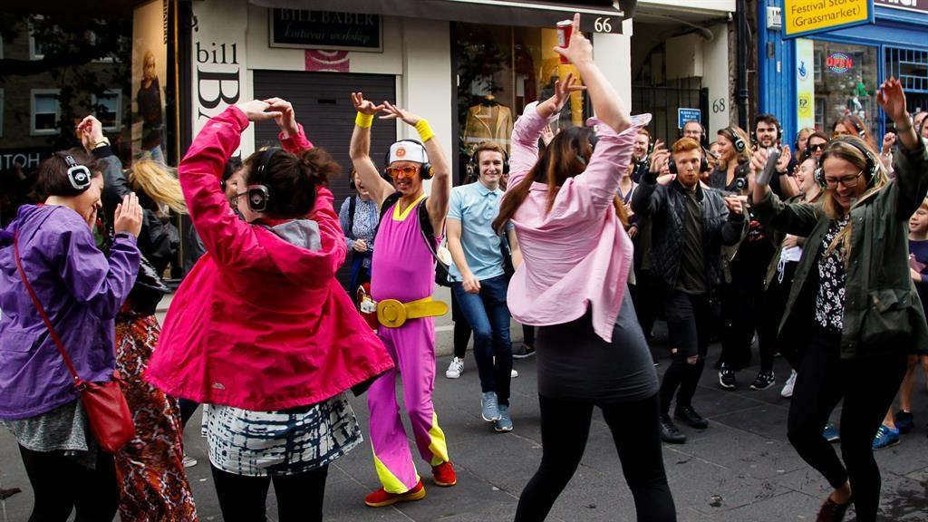 Festival fun: Disco organiser 'Guru Dudu' leads dancers at last year's Fringe PICTURE: SWNS