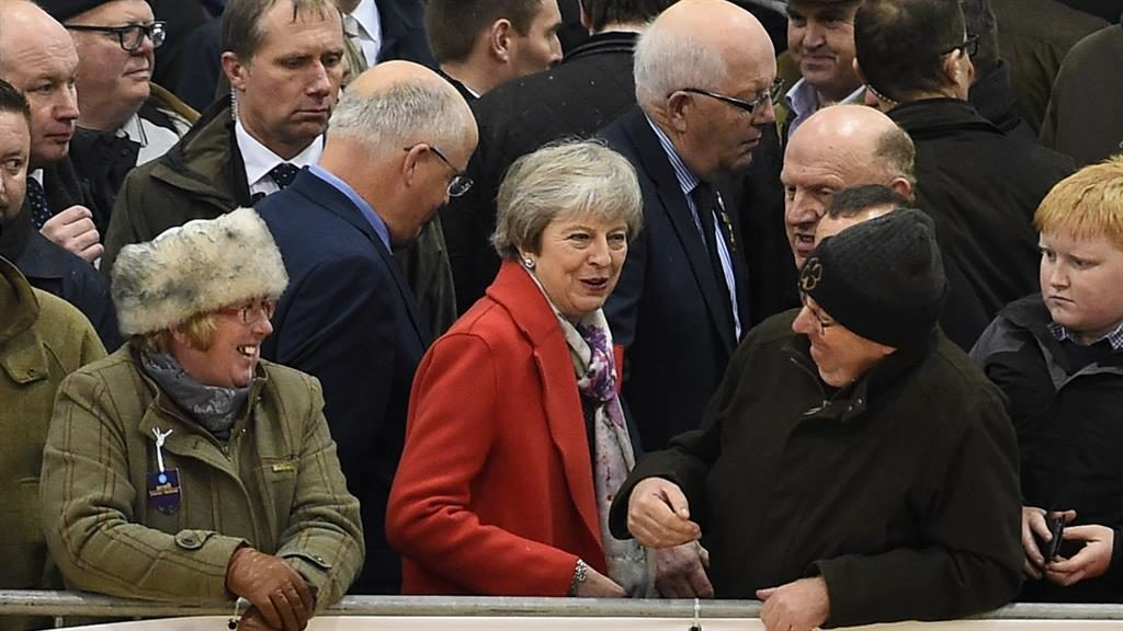 Drumming up support: Theresa May talks to farmers at Royal Welsh fair PICTURE: GETTY