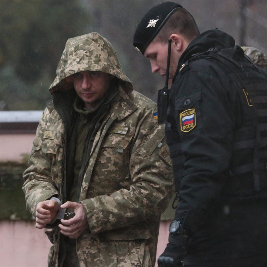 Captive: One of the detained Ukrainian sailors is escorted to a car after a hearing in Simferopol, Crimea, yesterday PICTURE: GETTY