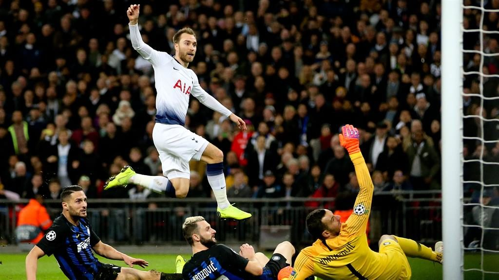 On the up: Christian Eriksen hurdles as he watches his winning goal hit the back of the net PICTURE: REX
