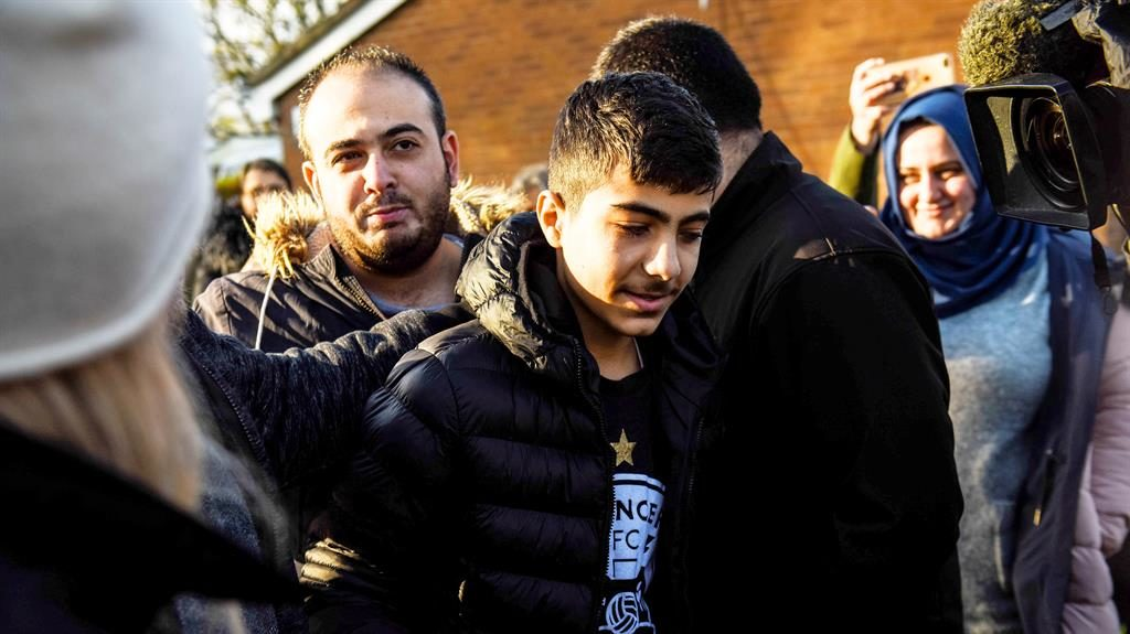 Thank you: Jamal with supporters outside the Huddersfield school yesterday PICTURE: SWNS
