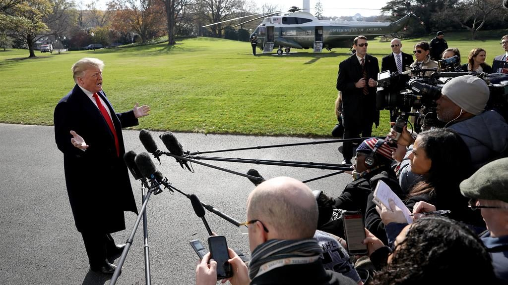 Protest: Donald Trump meets journalists at a White House press conference before leaving for Argentina PICTURE: GETTY