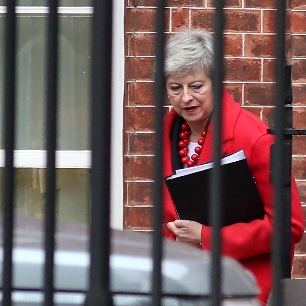 Tightrope: The PM needs three things to happen to keep her balance PICTURE: AFP/GETTY