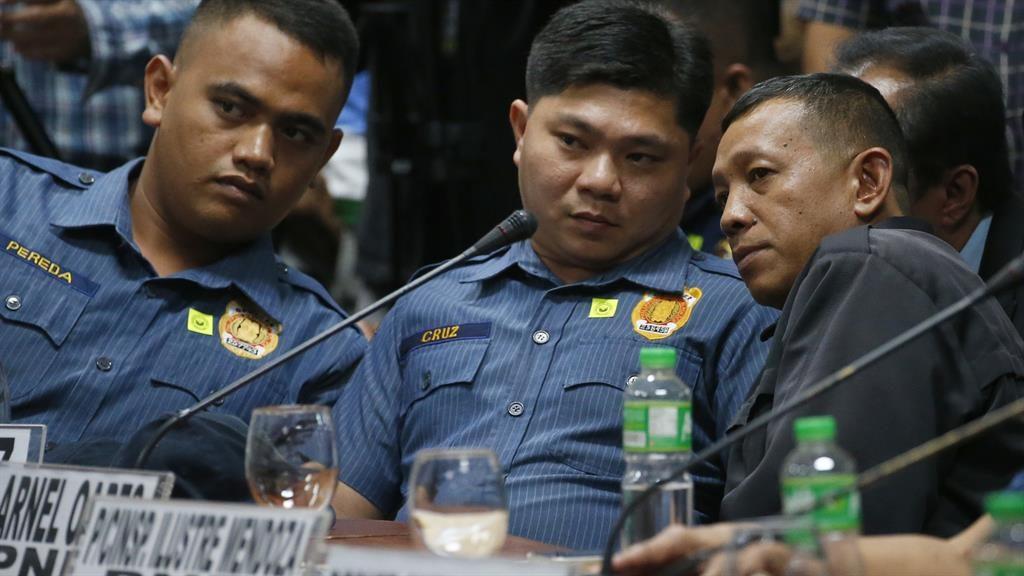 Behind bars: Jeremias Pereda, Jerwin Cruz and Arnel Oares PICTURE: AP