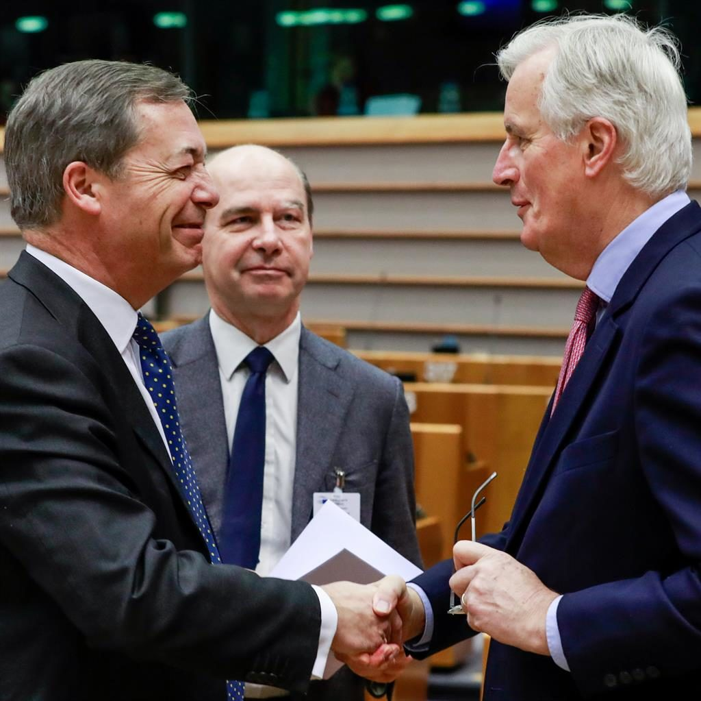 'Well played': Nigel Farage said it was 'game, set and match' to Michel Barnier (right) PICTURE: EPA