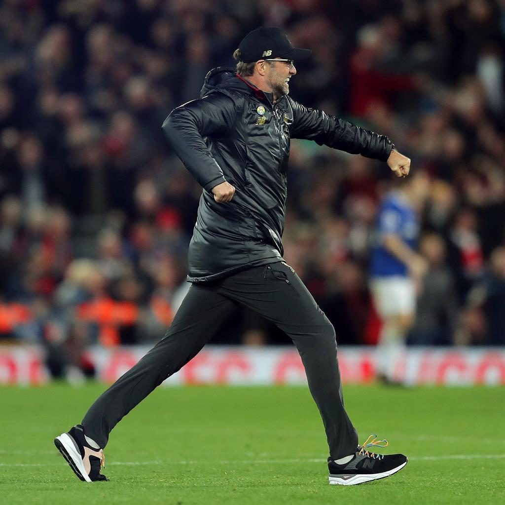 Klopp pitch invasion: Liverpool manager celebrates with players after late Origi goal