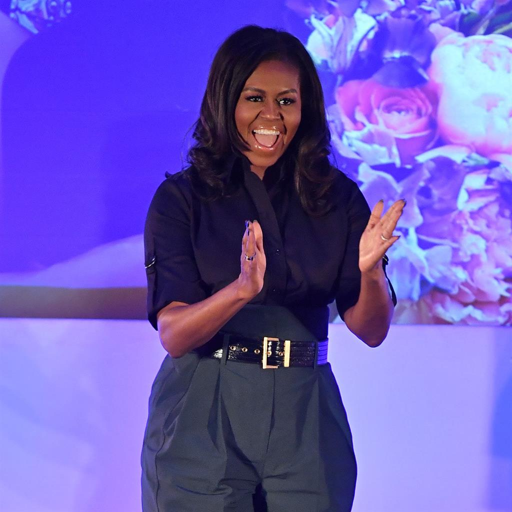 Michelle Obama on book tour encourages girls to 'practice sisterhood'
