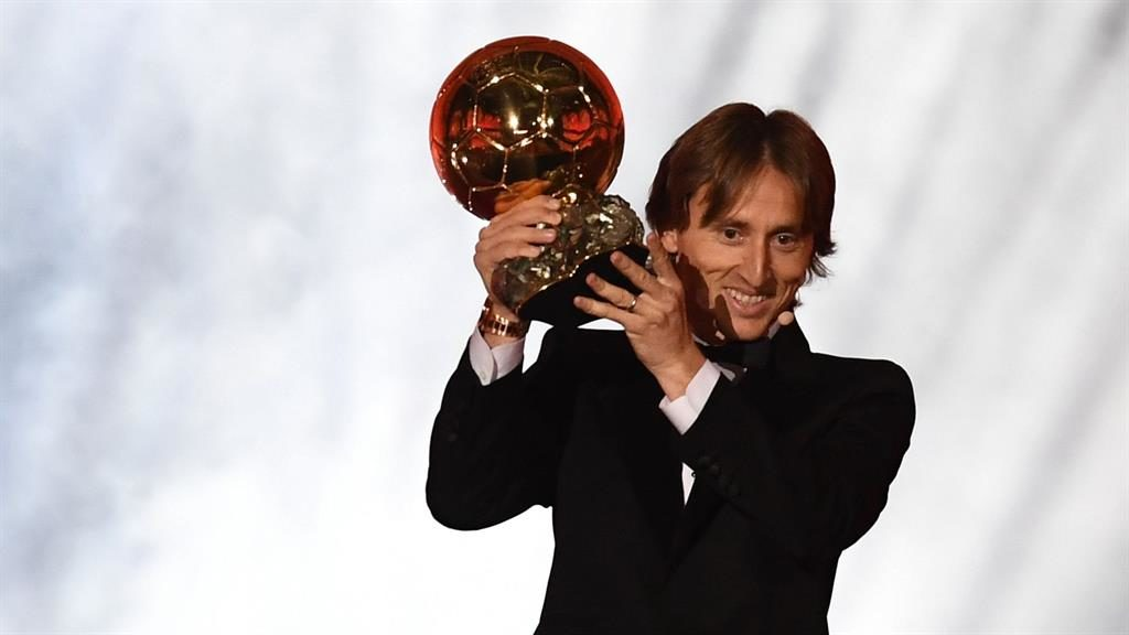 Winners: Modric and Hegerberg (below) with their awards last night PICTURE: EPA
