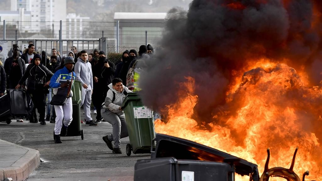 Pupils join in: High school students in Bordeaux set fire to a barricade of bins yesterday in protest at reforms in education PICTURE: GETTY