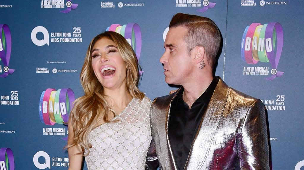 Have a little patience: Robbie's double take at laughing Ayda PICTURES: PA