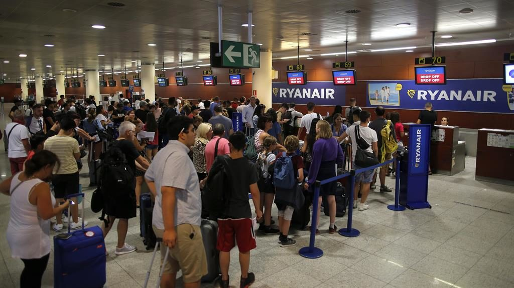 Grounded: Queues at Ryanair desk as Barcelona airport was hit by strike action last summer PICTURES: AP/GETTY/PA