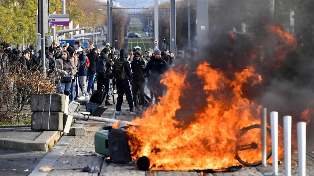 Anger on the streets: High school students set fire to a barricade in Bordeaux yesterday PICTURES: GETTY