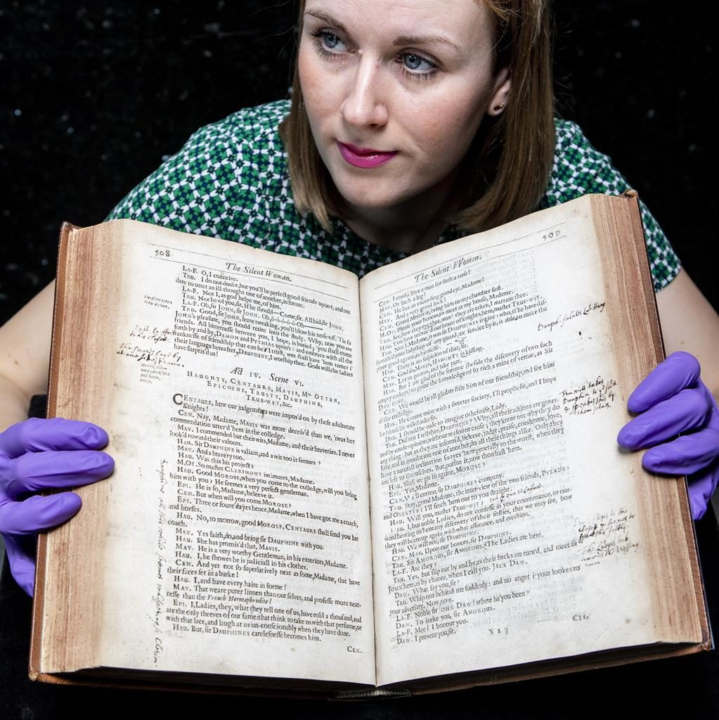 Historic: Exhibitions officer Kirsty MacNab with book PICTURE: SWNS