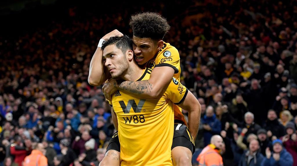 Golden boys: Morgan Gibbs-White congratulates Jimenez PICTURE: AMA/GETTY
