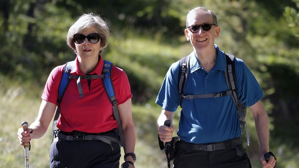Pushing on: Theresa May with her husband Philip during a walking holiday PICTURE: PA