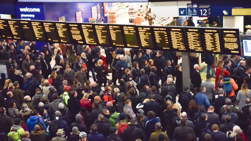 'Toll on family life': Passengers wait at London Waterloo amid disruption PICTURE: REX