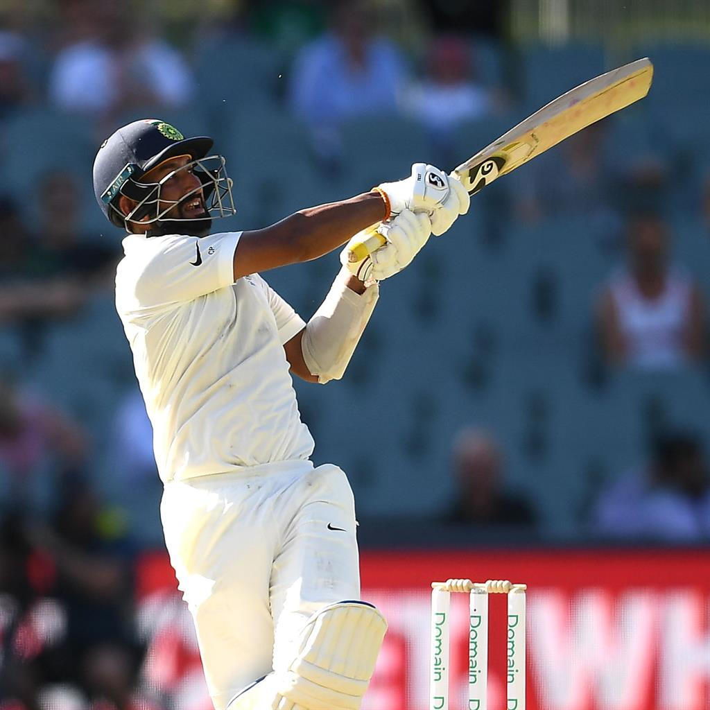 Rescue act: Pujara goes on the attack as he battles to turn around India's fortunes on the opening day in Adelaide