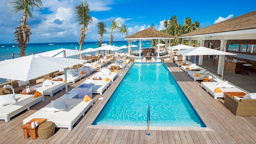 Exclusive: Mix with the party elite at Nikki Beach in Port Ferdinand