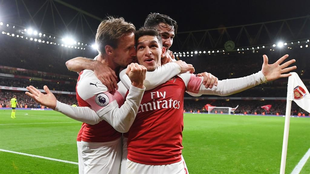Arsenal beats Huddersfield 1-0 to go 21 matches unbeaten