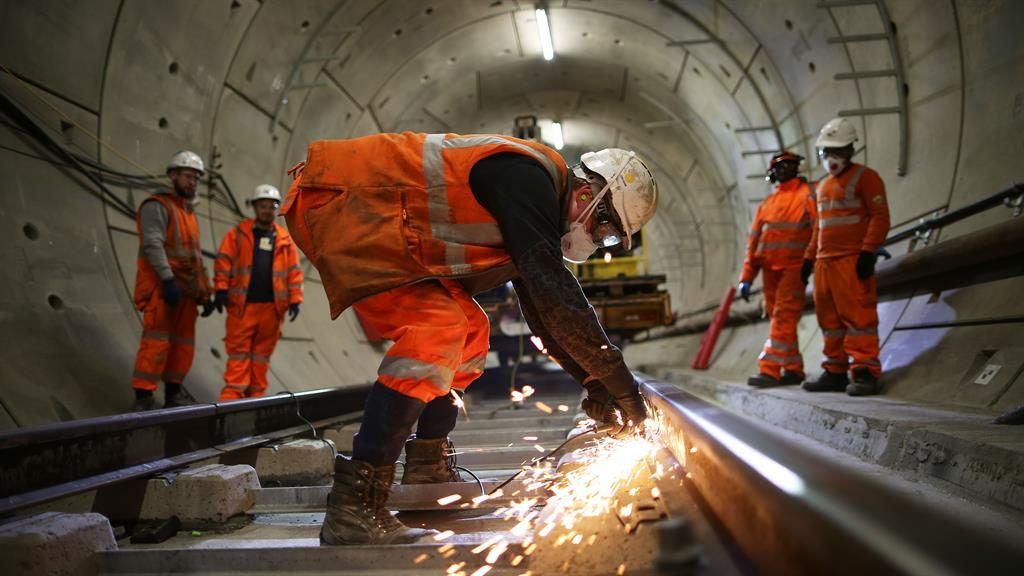Cost: Workers in Crossrail tunnel PICTURE: GETTY